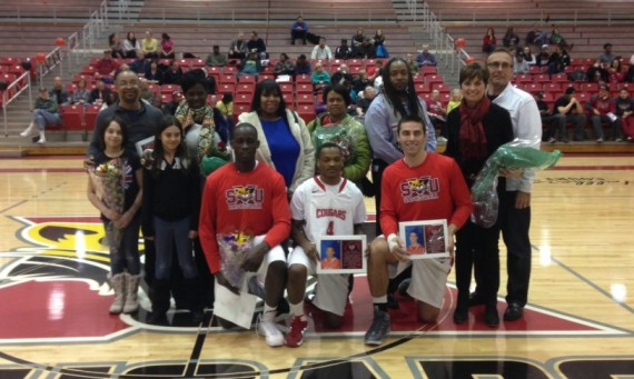 The 2013-14 SXU men's basketball senior class with families