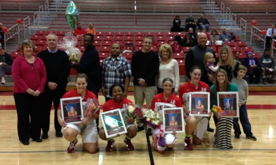 The 2013-14 SXU women's basketball senior class with families