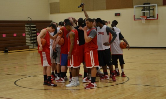 The team huddles together after its first practice session Tuesday in Branson, Mo.