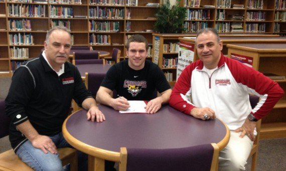 SXU coach Mike Feminis (right) joins signee Drey Devereaux (middle)