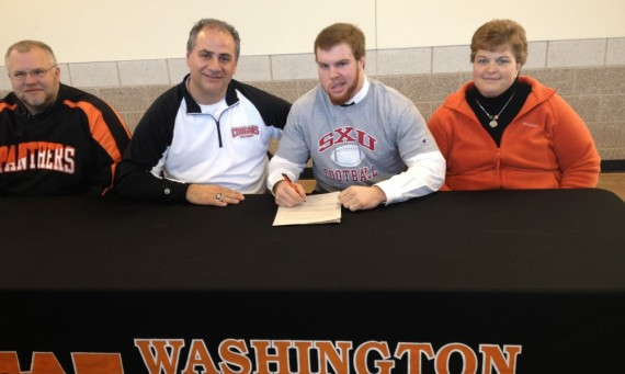 Coach Feminis joins Chris Friend for his signing at Washington High School