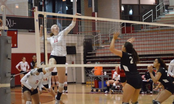 Junior Marie Hackert led the way for the Cougars with 13 kills and five blocks Tuesday