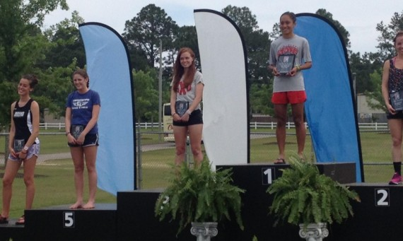 Senior Ashley Shares on the awards podium following Saturday's marathon in Gulf Shores, Ala.