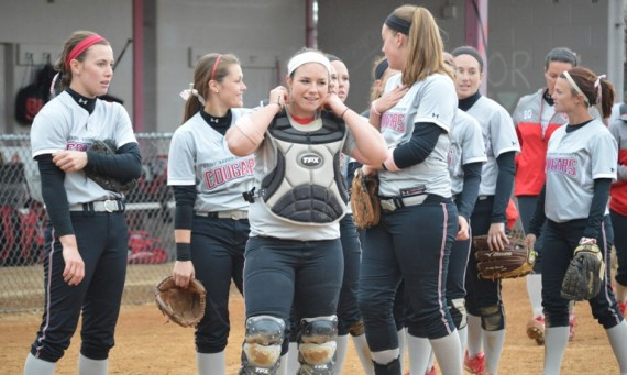 Junior Megan James (far right) hit a two-run homer Friday to help the SXU softball team advance