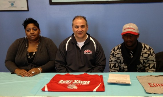 Chris Thompson (right) from V.O.I.S.E. Academy in Chicago recently signed with Saint Xavier Football