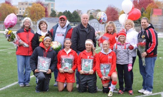 From left, seniors Anita Balciunas, Molly Sheehan, Rachel Wojtysiak and Jessica DePinto are honored with their families