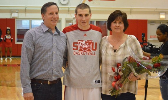 Senior Jack Krieger and his parents were honored prior to Saturday's game for Senior Day