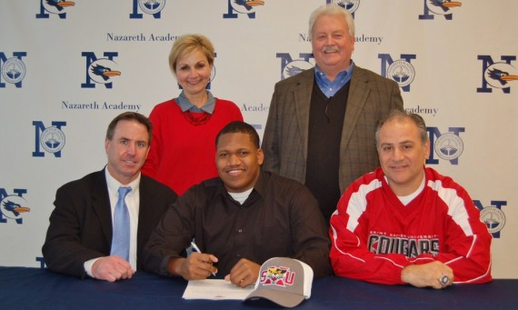 Dmitri Joe, a defensive lineman from Nazareth Academy, was one of Coach Feminis' key signings on Signing Day