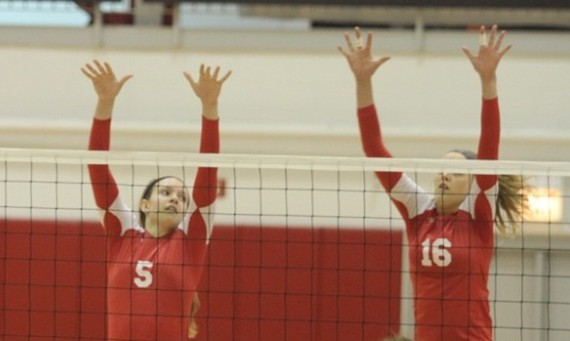 Junior Meghan Falsey (left) set a new career high with seven block assists against Rochester Friday