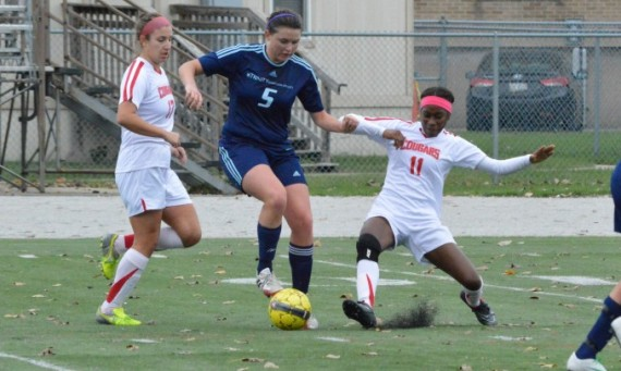 Senior Marissa Graves (far right) had SXU's lone goal in a 2-1 loss to Trinity Christian Saturday