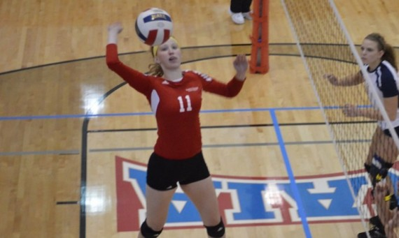 Senior Marie Hackert led the Cougars against Cardinal Stritch with 10 kills and two block assists