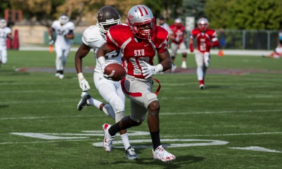 Junior Randell Wells scored three times Saturday with two TD receptions and a 100-yard kickoff return for a score