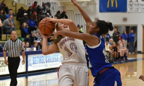 Senior forward Morgan Stuut drives to the basket vs Saint Francis (Ind.)