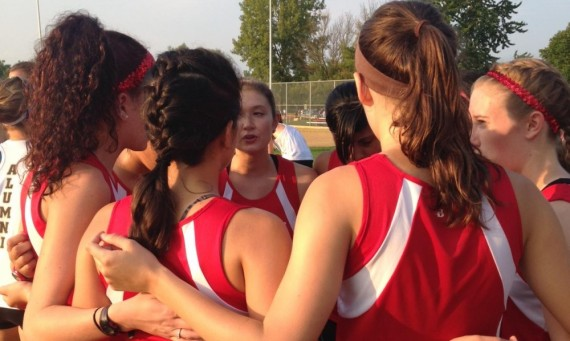 The SXU women's cross country team opened its 2014 season Friday evening at the Twilight Invite in Channahon