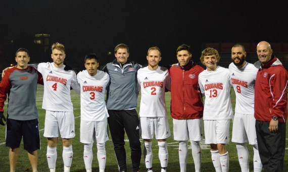 The 2015 SXU Men's Soccer Senior Class poses with the coaching staff before Saturday's game for Senior Night
