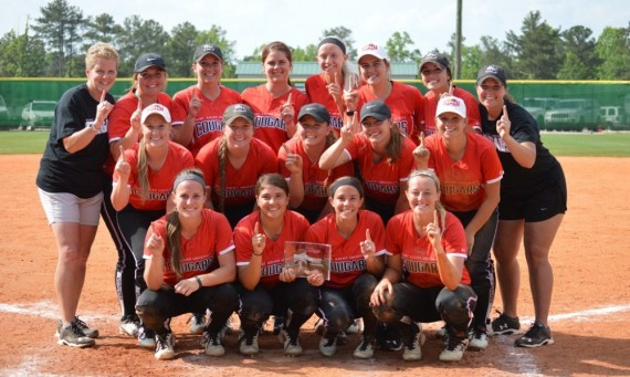 Head coach Myra Minuskin (left) and assistant Erin Mollohan (right) pose with the team after earning a NAIA World Series bid