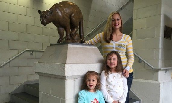 SXU cheerleading coach Julie DeCarlo (above) with daughters Madison (4) and Gabriella (2)