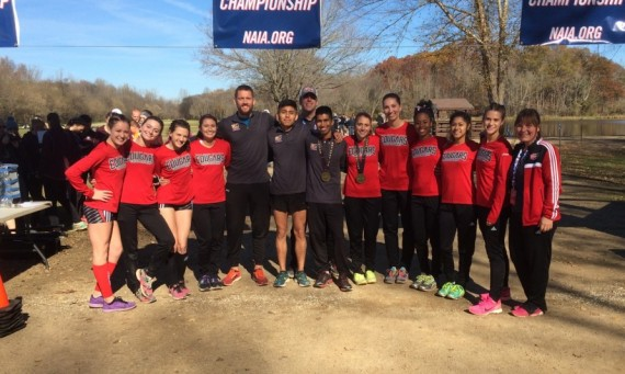 The SXU women's cross country team poses with coaches and men's qualifiers after finishing 22nd in the NAIA