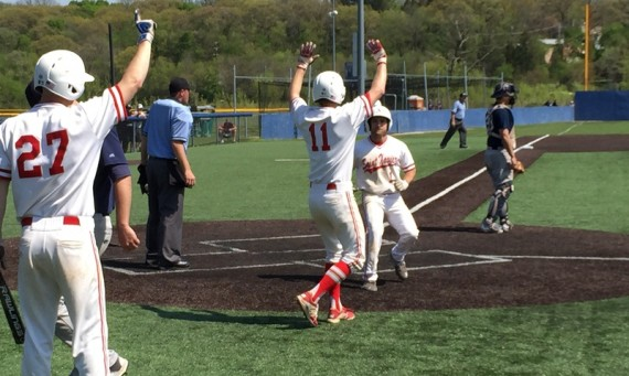 Sophomore Drey Devereaux scores one of SXU's seven runs in the eighth inning to fuel an 8-1 win over St. Ambrose
