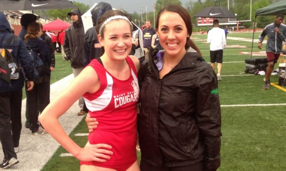 Junior Nicole Watkins (left) celebrates with former record holder Jackie Ott Friday after setting new outdoor 800 meter mark