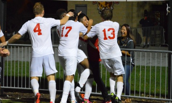 Freshman Orlando Tapia and his SXU teammates celebrate after Wednesday's thrilling 2-1 victory over Goshen College in OT