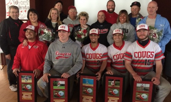 The SXU Baseball Senior Class celebrates with coaches and family members after Saturday's suspended game