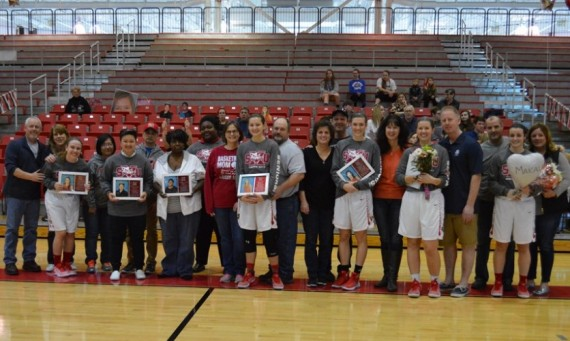 The seven senior players and managers for SXU women's basketball were honored with their parents before Saturday's game