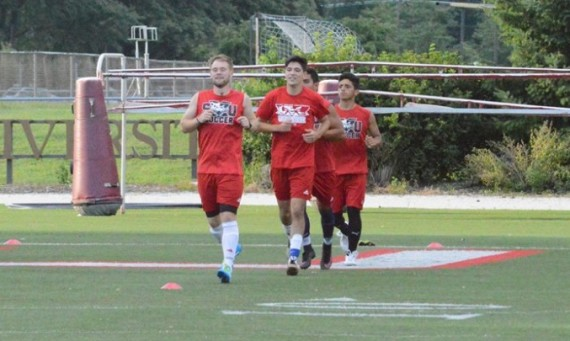 Senior Peter London leads a drill during a recent practice session for SXU men's soccer