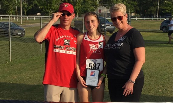 Junior Ellie Willging celebrates with her parents following Saturday's 5K race where she finished as national runner-up