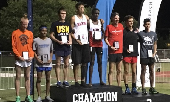 Senior Abel Hernandez (far right) on the podium as an All-American following his eighth place finish in the 10K Thursday