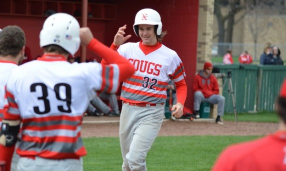 Freshman Matt Monahan celebrates with teammates after his grand slam against Lewis University Tuesday