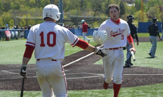 Senior Ryan Pellack (#10) celebrates with freshman Ben Zordani in SXU's 13-2 win over Purdue-Northwest in the CCAC Tourney