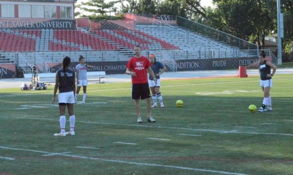 SXU women's soccer coach Evan Strehlau talking to his team during a recent preseason practice session